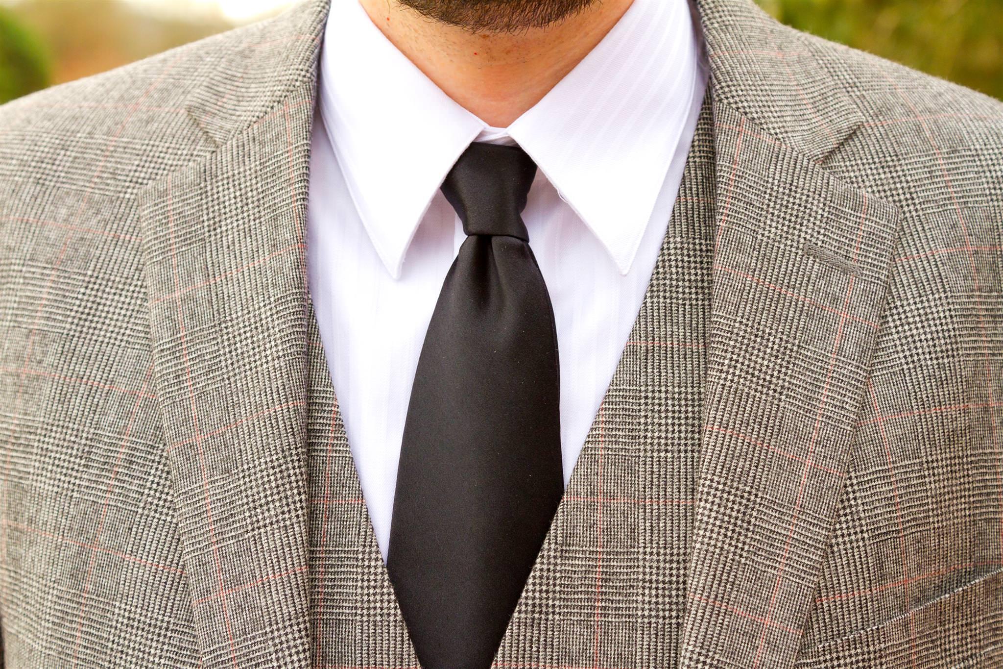 Tweed Suit with Black Tie