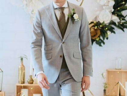 man walking down aisle with grey wedding suit