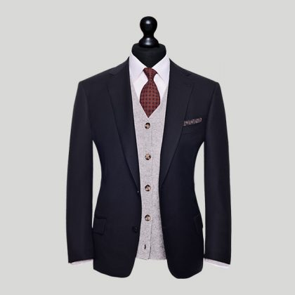 black suit jacket with white waistcoat wedding suit