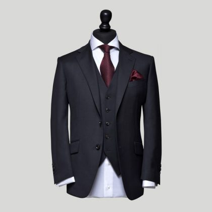 charcoal 3 piece suit with red undetones