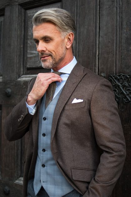 brown tailored suit with grey waistcoat